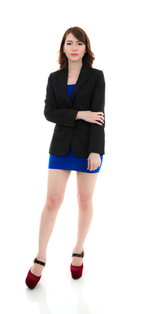 Portrait of a young attractive business woman against white background Stock Photo
