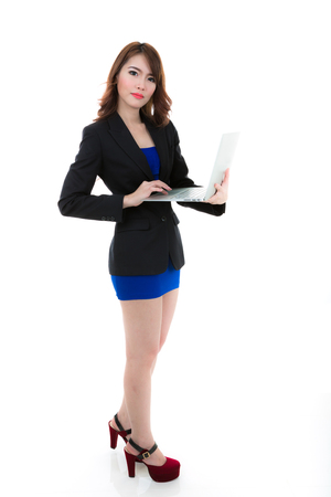 Business woman working with laptop isolated on white background