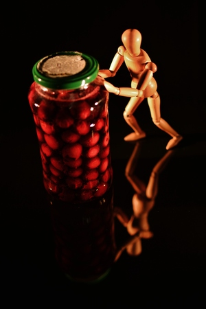 wooden doll: canned fruit with wooden doll