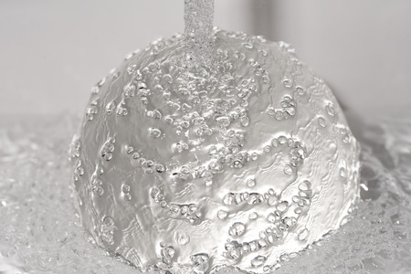 water jet: Water jet hits a glass ball