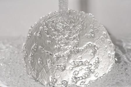 handwashing: Water jet hits a glass ball