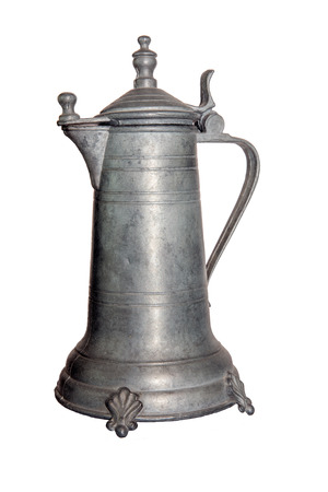 Old Coffeepot or wine decanter of tin