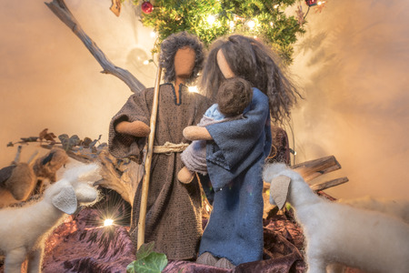 Adam and Eve at Christmas as fabric dolls with fabric animals and christmas tree