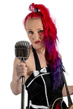 RocknRoll singer with red hair, guitar and microphone