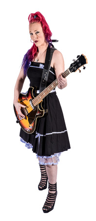 Standing RocknRoll singer with red hair and guitar 版權商用圖片