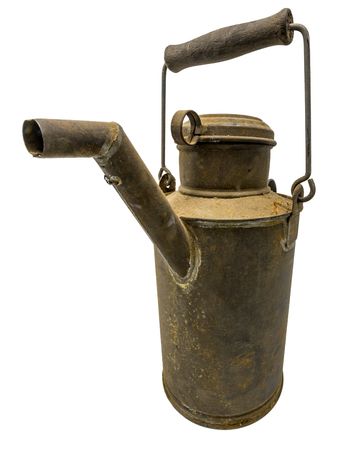 Old dirty oil can of tin with carrying handle isolated on white Standard-Bild - 116295403