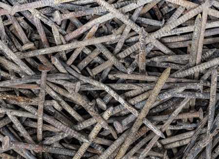 Old rusted nails uniformly frame-filling distributed as a background Standard-Bild - 116295453