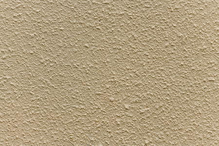 Bright beige rough plastered house wall frame as a background Standard-Bild - 116295468