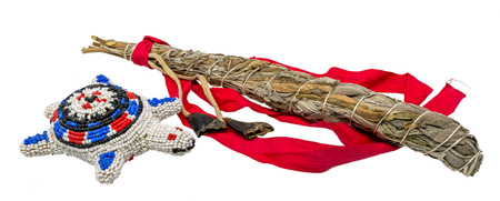Indian umbilical vessel with a bundle of white sage for smudging in the esoteric Indian area isolated on white Standard-Bild - 116295517