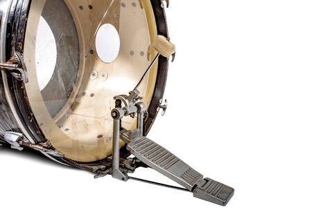 Large bass drum with racket and foot pedal on white background Фото со стока