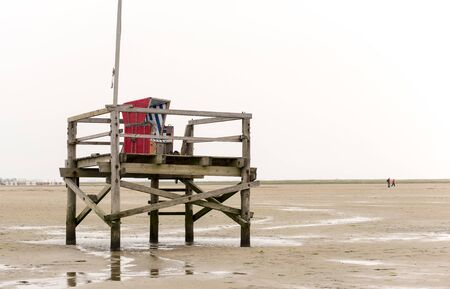 Bathing platform made of wood with beach chair in the Wadden Sea on the German North Sea coast at low tide Reklamní fotografie