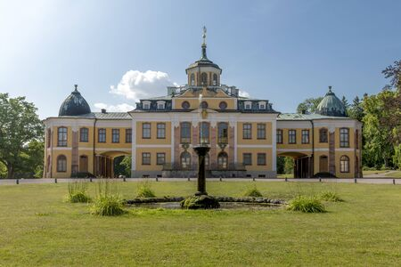 Castle Belvedere in Weimar Germany with fountain and forecourt in front of blue sky Фото со стока
