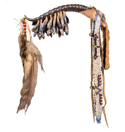 Dance rattle of the North American Indian horn with deer hooves and feathers isolated on white Stock fotó