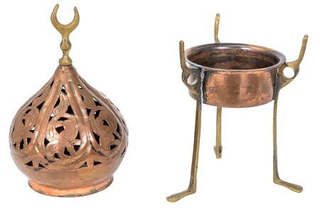 Old oriental incense burner made of copper isolated on white