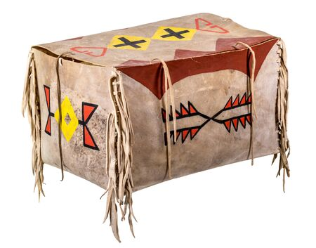 Transport box made of rawhide indian painted with leather cords isolated on white
