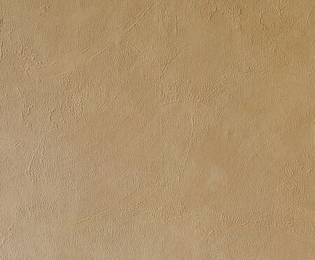 Bright beige rough plastered house wall frame as a background