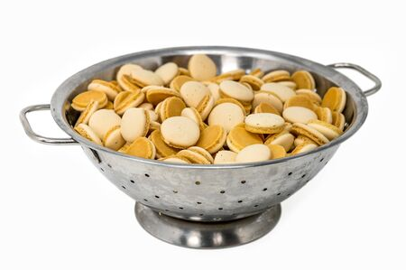 Homemade anise christmas cookies in a metal bowl isolated on white