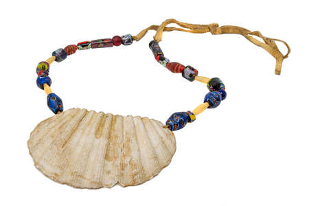 Indian necklace with a large seashell and old glass beads on a leather cord isolated on white 写真素材