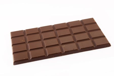 bar of chocolate on a white background photo