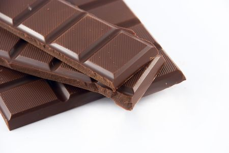 slices of chocolate on a white background photo