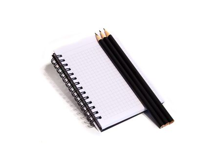 notepad and pencils on a white background Stock Photo - 5092746