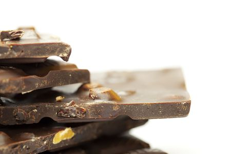 pieces of chocolate with nuts and raisins folded mountain, isolated on white Stock Photo - 6659486