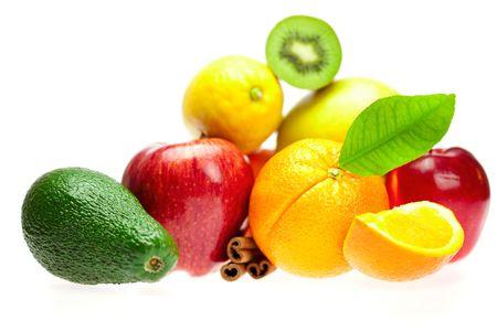 kiwi, avocado, apples, orange, lemon, and cinnamon, isolated on white photo