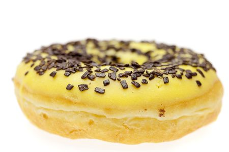 Donut with chocolate and colorful sprinkles, isolated on white Stock Photo - 6659431