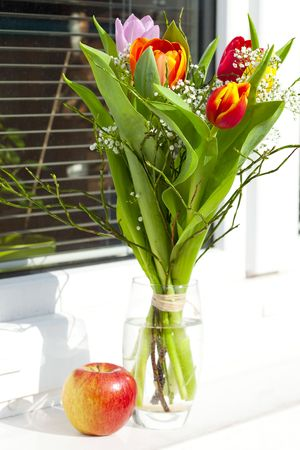 spring bouquet with tulips and an apple photo