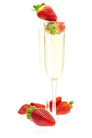a glass of champagne and strawberries photo