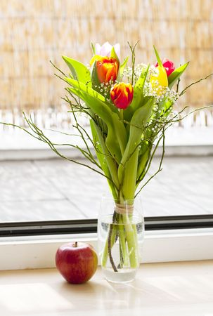 spring bouquet with tulips and an apple Stock Photo - 6730305