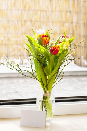 a spring bouquet with tulips photo