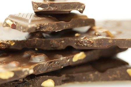 stacks of pieces of chocolate isolated on white photo
