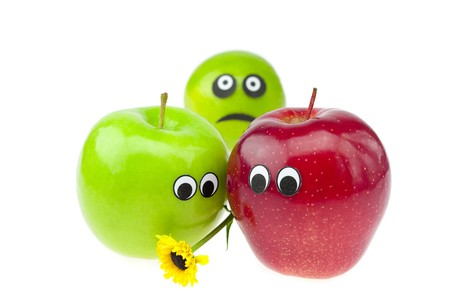 joke apple and lime with eyes isolated on white photo