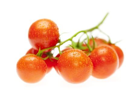 juicy tomatoes isolated on white photo