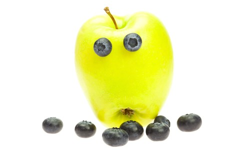 funny little man from the apple with the eyes of blueberries isolated on white photo
