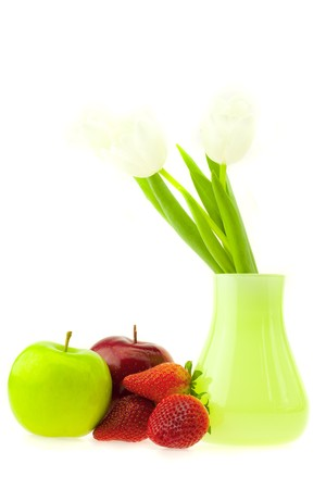 still life of tulips and apples isolated on white photo