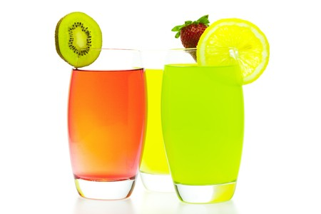 colorful cocktails with slices of fruit isolated on white