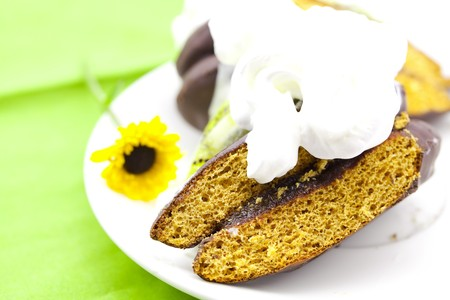 cake with cream and a flower on a green background Stock Photo - 7181413