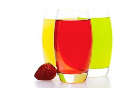 thirsting: colored cocktails with strawberries isolated on white