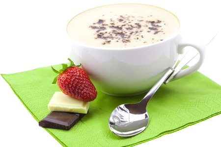 cappuccino with chocolate and strawberries isolated on white