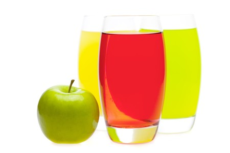 thirsting: apple and juice in glasses isolated on white