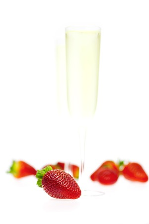 Strawberries with champagne isolated on a white photo