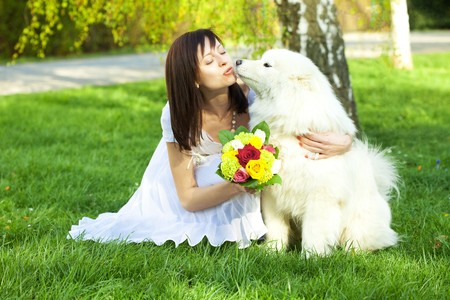 young bride and the dog on the nature photo