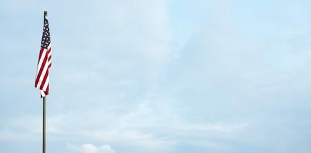 American flag against the blue sky photo
