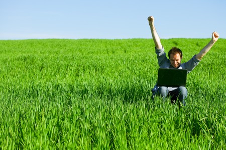 Young man using a laptop outdoors Stock Photo - 7200227