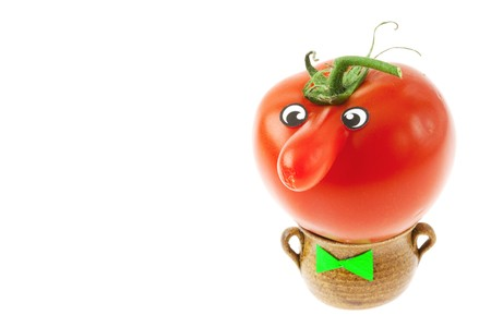 tomato with a nose lying in a small jug isolated on white photo