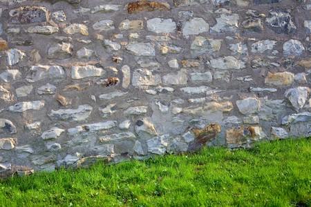 brick wall and green grass photo