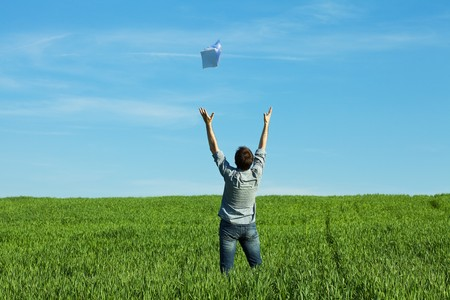 man throws the paper in the field Stock Photo - 7221886