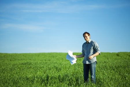 man throws the paper in the field Stock Photo - 7221878
